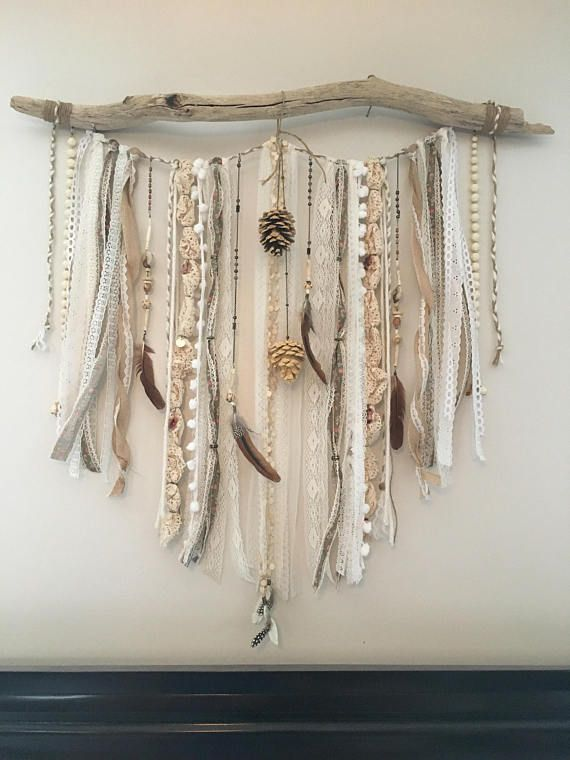 Handmade one of a kind lace wall hanging made from driftwood, vintage laces, ribbons and beads, feathers and pine cones. Rustic and delicate at the same time. This piece is large, measuring approximately 35 x 35, as it demands to be the center of attention! Lovely over a bed or on a large wall.