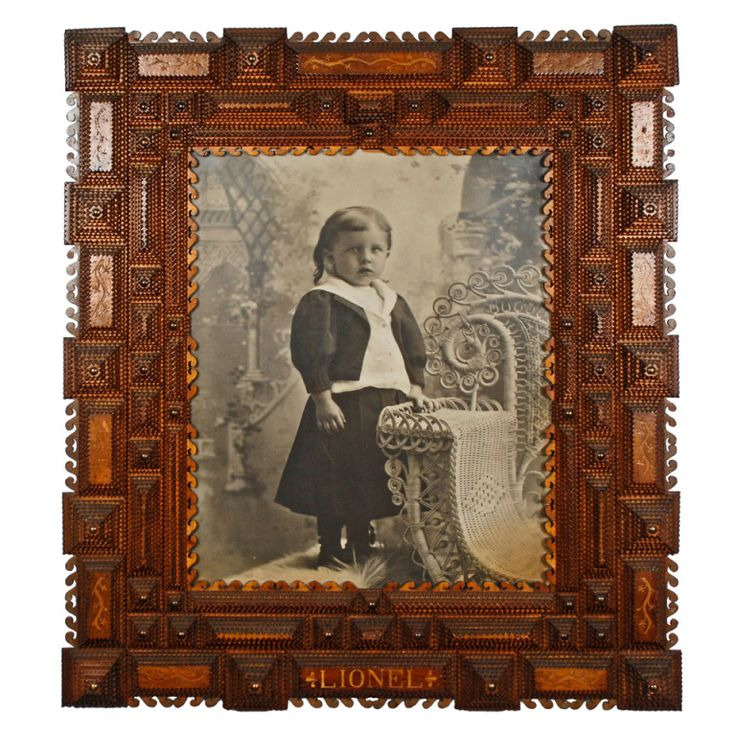 Fancy Tramp Art Frame Inscribed 'Lionel' | From a unique collection of antique and modern frames at http://www.1stdibs.com/furniture/wall-decorations/frames/