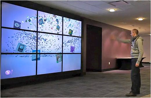 An interactive video wall at Yahoo!'s campus that has nine screens. It engages with the viewers as they pass by the screen. As people walk by the display the video wall begins to interact with viewers by sensing the viewer's presence.