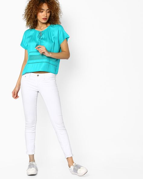 Find the latest and stunning collection of trendy tops online. Ajio is one of the best shopping site to buy the latest fashionable tops at reasonable prices.