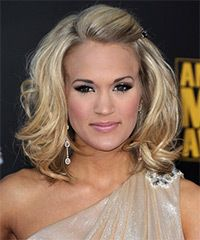 Medium to long layers allows this hairstyle to bounce up to achieve body and fullness to this look. The top has been teased and pinned back for height and shape.