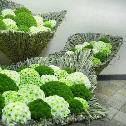 Green spheres of pom poms  and green ball carnation-------I'm sorry but everyone at the wedding probably thought it was broccoli and cauliflower