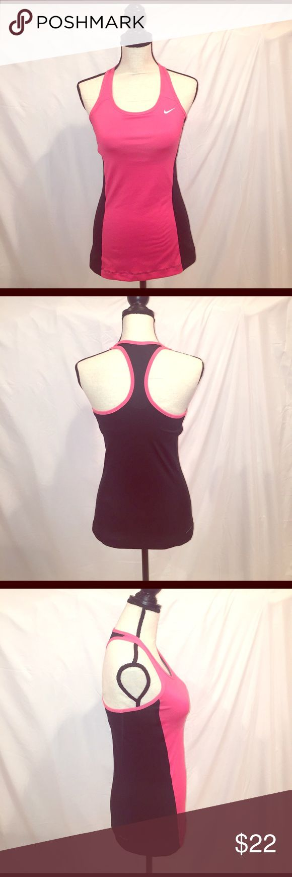 Nike Dri Fit Razorback Tank Top/Bra EUC Nike Dri Fit Razorback Tank Top/Bra EUC. The Nike logo has lifted in one area and is in pic. Otherwise this tank/bra is flawless. It's the pinkish coral with black. Dark gray bra attached. Nike Tops Tank Tops