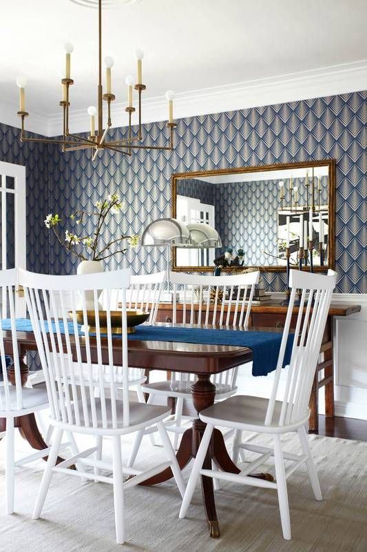 emily henderson design navy wallpaper dining room with white dining chairs