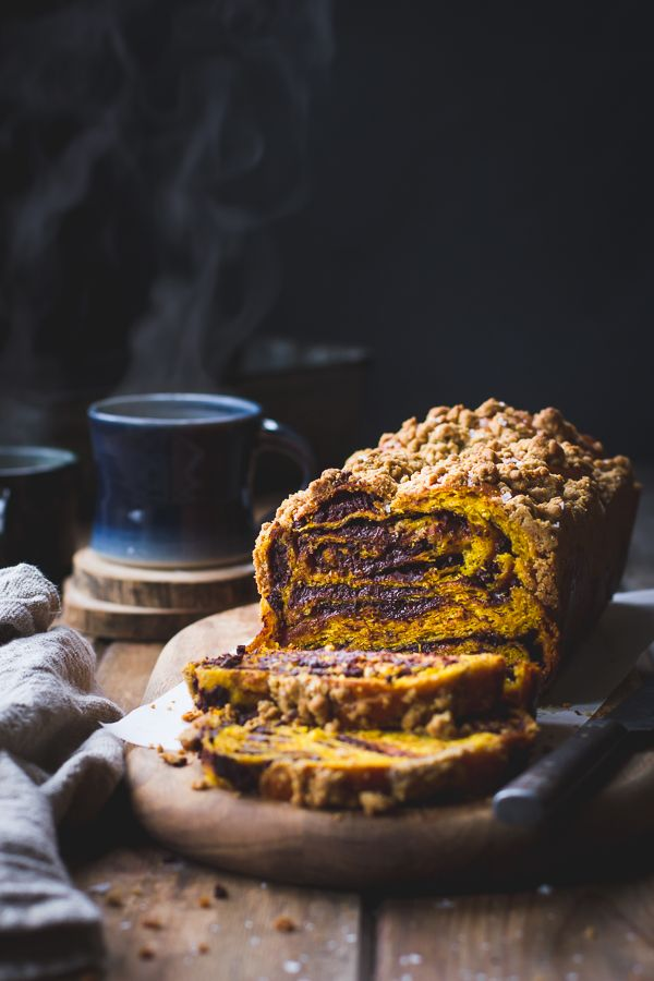 This babka recipe features a golden challah-like dough kissed with rye flour and kabocha squash puree filled with a swirl of spiced chocolate, all topped with a salted maple sugar and rye flour str…