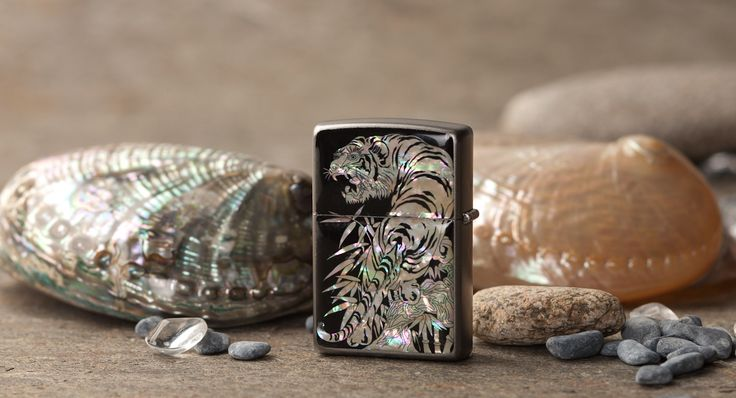 http://www.antiquealive.com/store/detail.asp?idx=5169 Zippo Mother of Pearl Cigarette Lighter with Tiger in Bamboo Forest