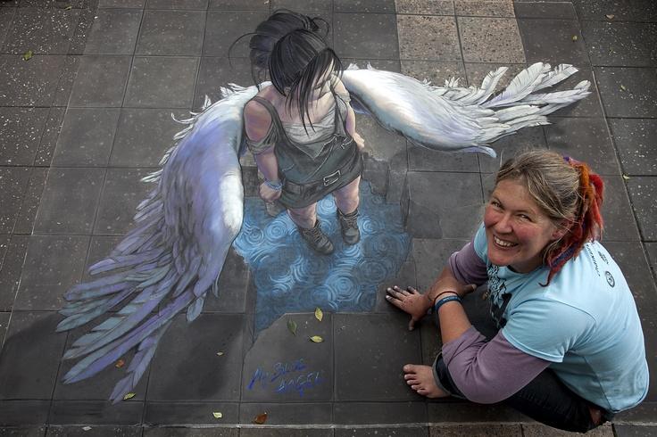 Jenny McCracken with her winning artwork from CUAF 2010 – 'My Blue Angel' ( medium :: chalk on pavement : )