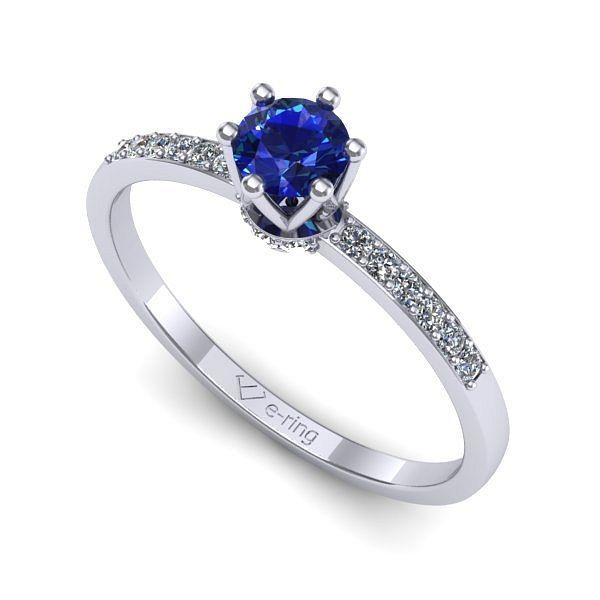 Inelul este realizat din aur alb 14k, greutate: ~1.80gr. Produsul are in componenta sa: 1 x safir, dimensiune: ~4.00mm, culoare: ALBASTRU, forma: round 6 x diamant, dimensiune: ~1.10mm, greutate totala: ~0.04ct, culoare: G, claritate: SI1, forma: round 12 x diamant, dimensiune: ~1.30mm, greutate totala: ~0.12ct, culoare: G, claritate: SI1, forma: round