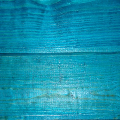 Create a stain for wood floors, with some variance between turquoise and peacock blue, still beautifully showing the grain.