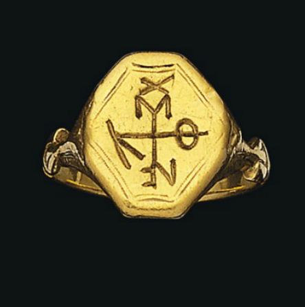 A BYZANTINE GOLD RING   CIRCA 10TH CENTURY A.D.   The hexagonal bezel engraved with a cruciform monogram, the shoulders with engraved decoration  Bezel; 5/8 in. (1.6 cm.) wide
