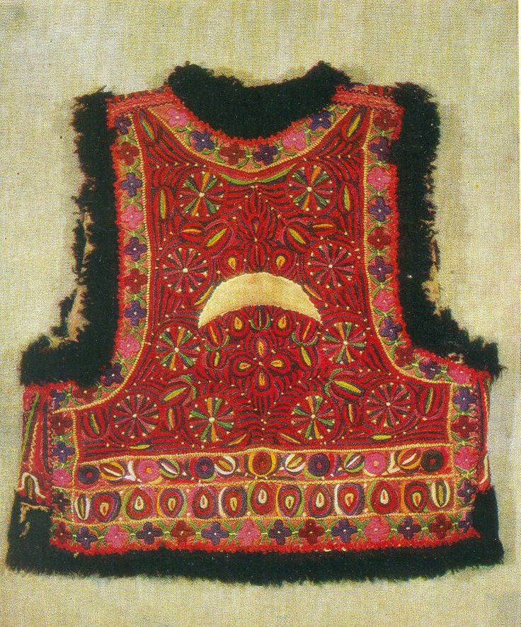 traditional motifs and colors on embroidered vest