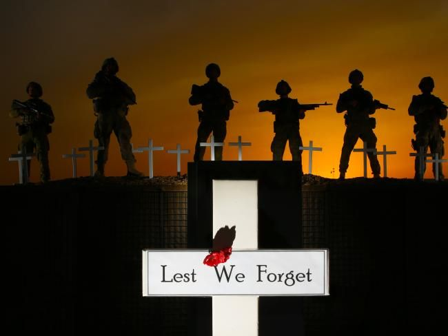 Lest We Forget... Australian and New Zealand soldiers stand shoulder to shoulder on Anzac Day in Taji Iraq. Picture Gary Ramage/News Corp Australia