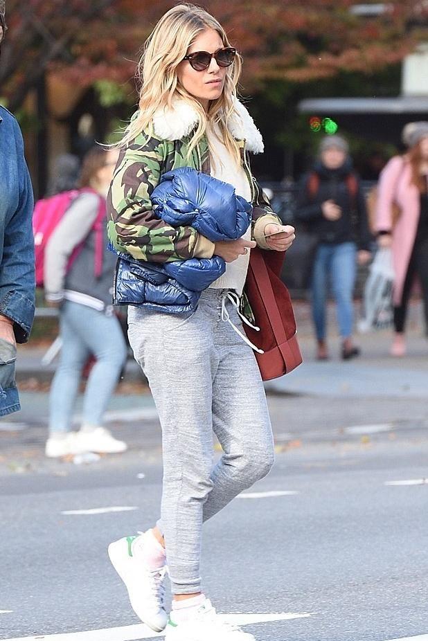 Sienna Miller wearing Rag   Bone Walker Sling Suede Bucket Bag in Rust,  Adidas Stan Smith Sneakers and Rag   Bone Shearling-Trimmed  Camouflage-Print ... 8a186ae616