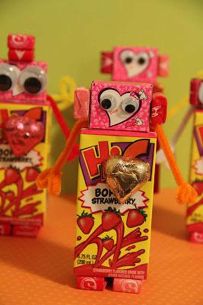 The cutest Valentine's Day robots! Throw in some Starburst, Dove chocolates & a Hi-C pack and voila!