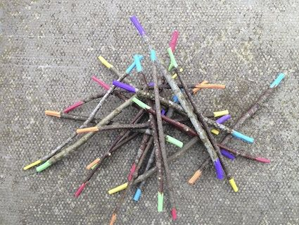 Pick up sticks, each color is assigned a numerical value, then you add what you pick up, or you can assign colors place value