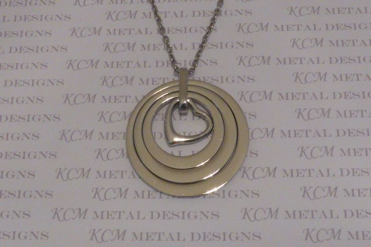 This is the 'Narelle' necklace. 38mm outer diameter and 2mm thick. Available in Stainless Steel Gold $80 and Stainless Steel Silver $70. You can choose your own names to have stamped on it or leave it blank.