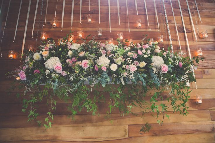 Hanging floral backdrop by Flower Lounge, VS Events styled wedding. Photography by Kate O'Neill