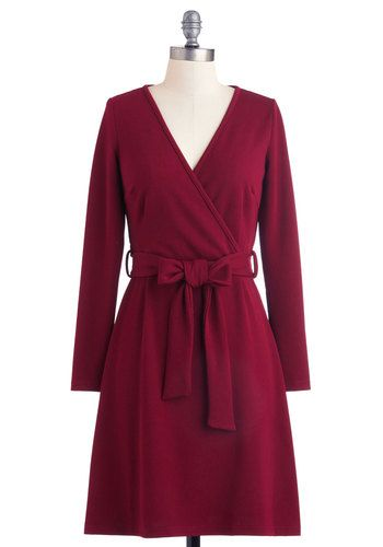 burgundy wrap-style sheath. slightly textured, figure-hugging fabric, surplice neckline, and effortless sash