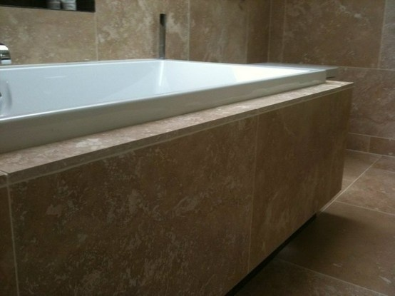 Bath On Plinth · TravertineMarbleBathroom