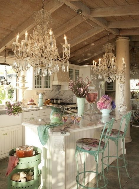 A farmhouse style kitchen glammed up with not one, but two crystal chandeliers!