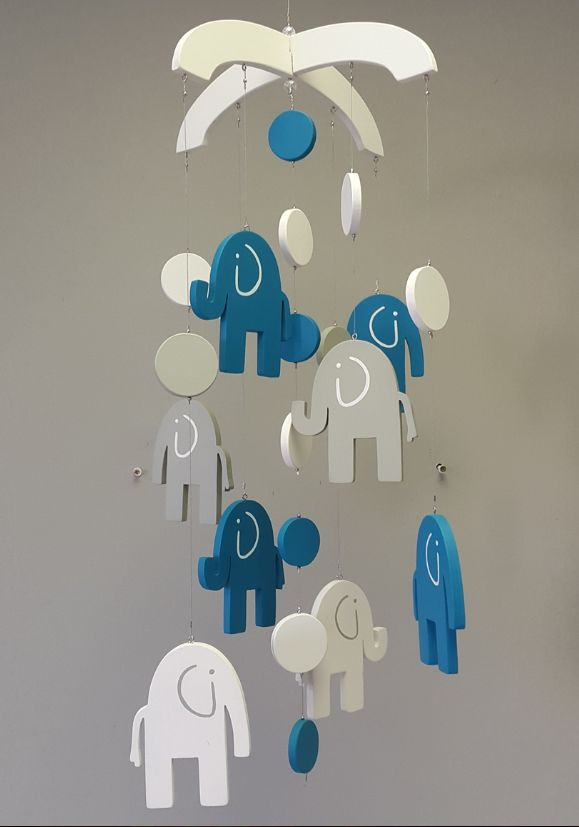 Our wooden #ElephantTheme #BabyMobile in #turquoise and #grey is absolutely perfect for both a #BabyBoy or a #BabyGirl!  #BabyBeding #BabyLinen