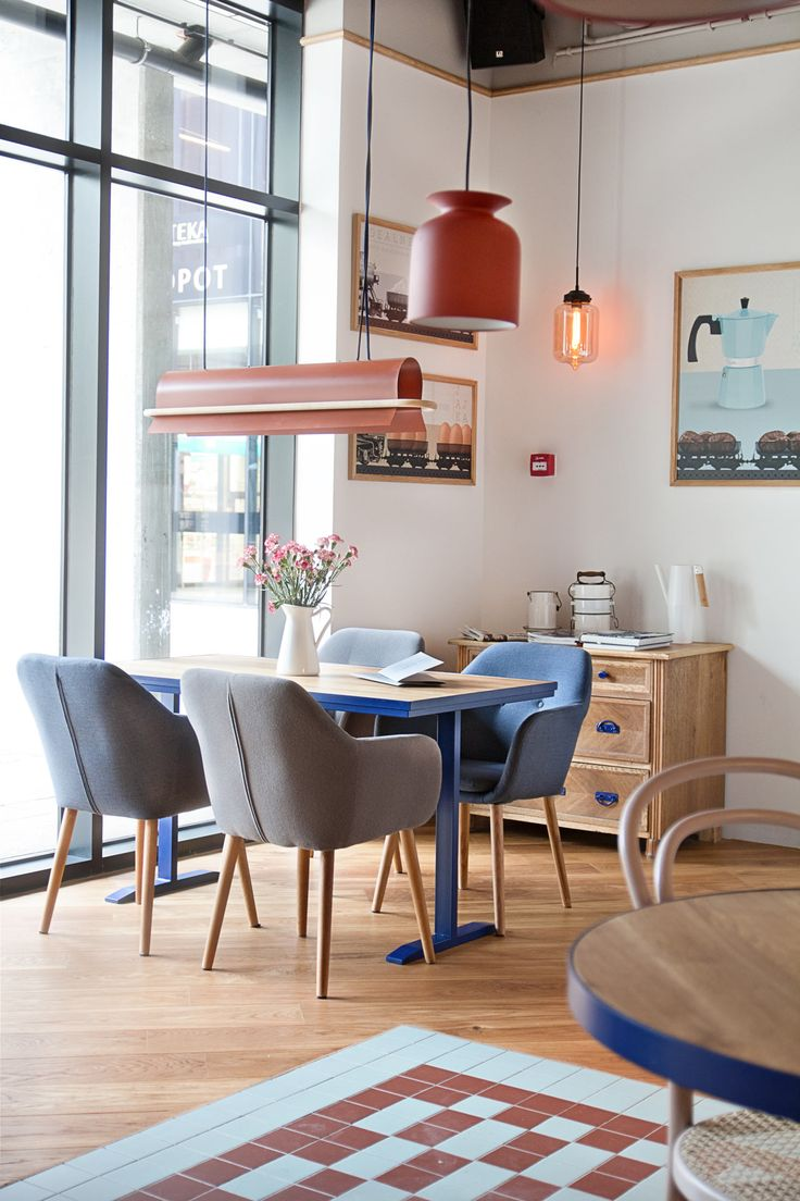 Cafe in Poland with pastel chairs and accent lighting