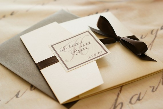 A pocket invitation gives the opportunity to use a bow, the loveliness of opening the invitation, and a pocket to hold an RSVP card, wedding registration card, and a picture. Can be any color, style.