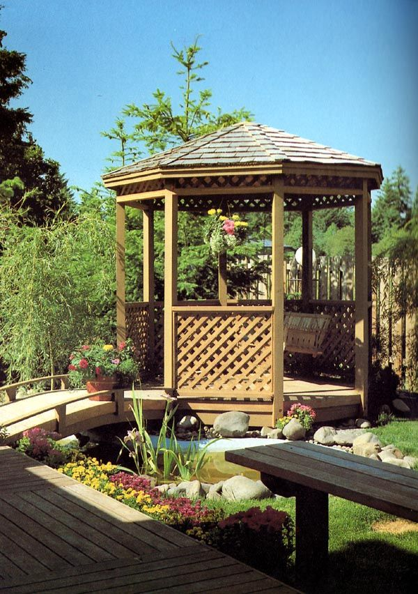 #GazeboPlan 504383 | Add something unusual to your yard or garden with this gazebo. Here it is connected to the deck by a bridge over a small lily pond. But even if you don't have a lily pond, you can enjoy many pleasant hours in this cleverly designed retreat with its accents of lattice panels.