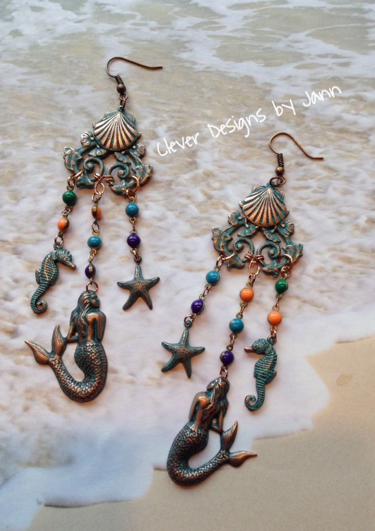 """""""Adventures In The Sea"""" Chandelier Earrings .. I cut a Filgree Wrap Leaf Stamping in half and glued a clam shell at the top .. Hanging from that are a mermaid, seahorse & starfish  .. FOR SALE .. $27.00 https://www.facebook.com/JewelsByJann"""
