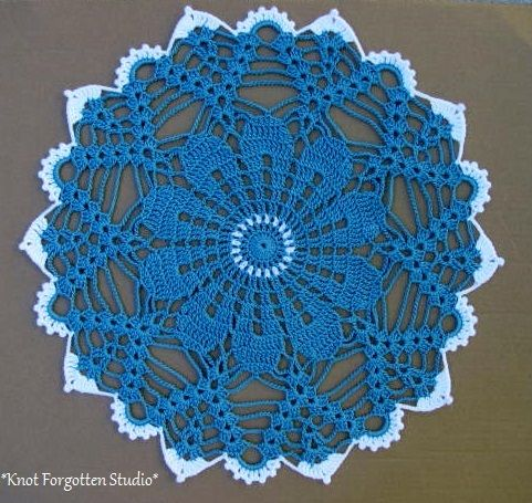 This Doily is called Moon-Beams. The pattern is from Magic Crochet. Finished June, 2014. https://www.pinterest.com/KnotForgottenSt/knot-forgotten-studio/
