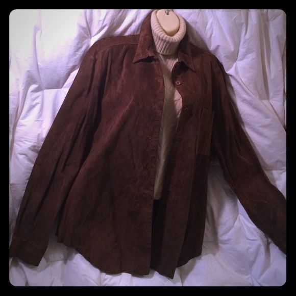 "SARAH CHAPMAN Suede Shirt/Jacket Long sleeve, suede, button down shirt/jacket. 1 front breast bucket, 7 front button closure, tapered hem. Just back from the cleaners. 4th picture is natural aberration and is not dirty. Must have for the transitional season. B up to 50"" W up to 42"" L 25"". From my closet to yours! Sarah Chapman Jackets & Coats"