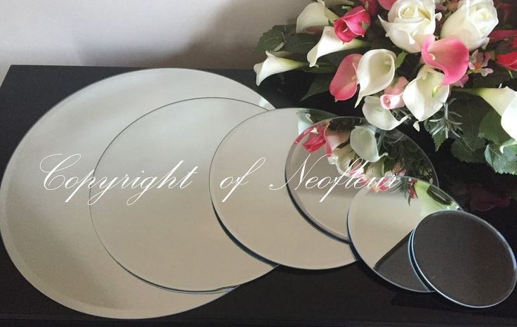 Super Quality Round Clear Glass Bevelled Edge Mirror Plates. Plates are individually boxed with bevel edge and non slip rubber feet. Perfect for any wedding / party venue table decorations, floral displays & Candle Plates. | eBay! 10 for £70 40cm