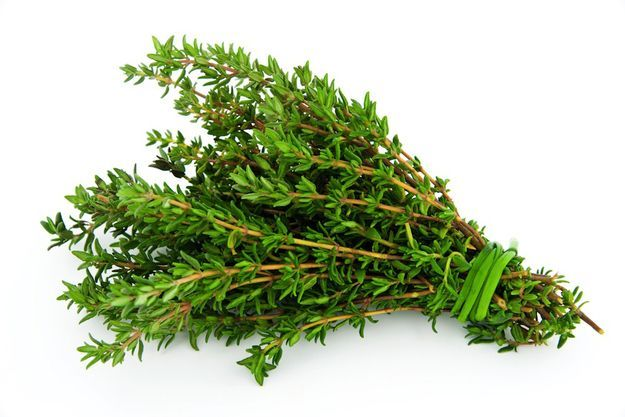 Treat oily herbs differently.  Thyme can be tied loosely together and hung in open air.