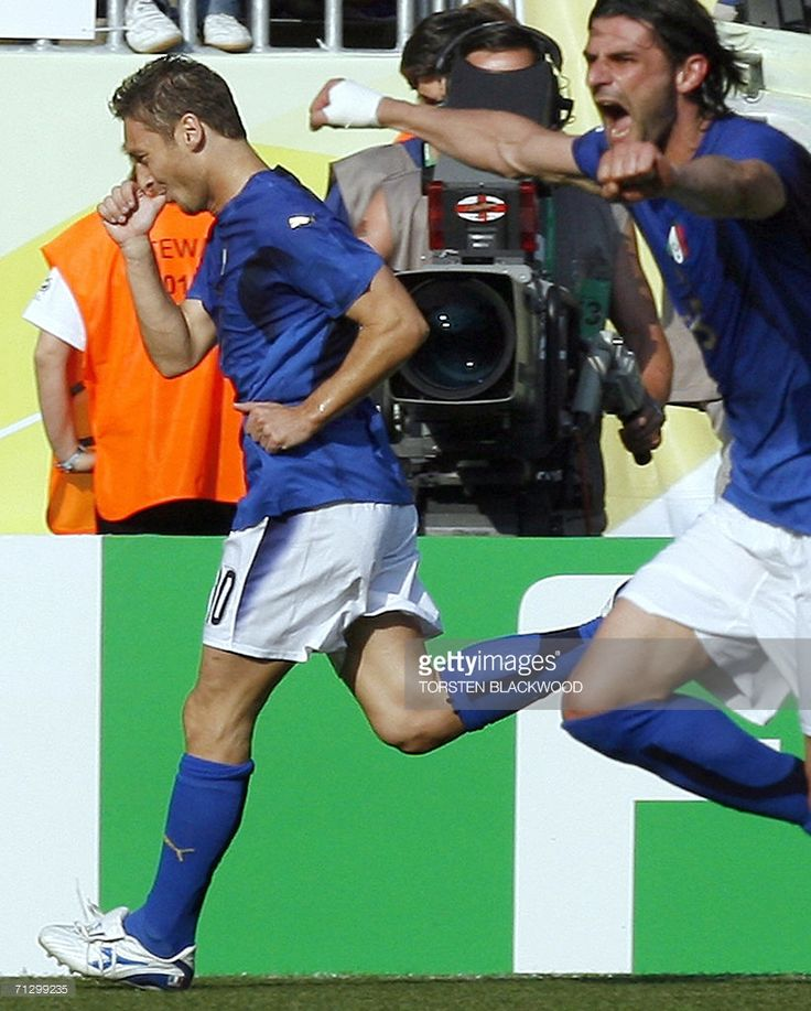 Italian midfielder Francesco Totti (L) sucks his thumb in honour of his son as he celebrates after scoring on a penalty kick for the game-winning goal in the round of 16 World Cup football match between Italy and Australia at Kaiserslautern's Fritz-Walter Stadium, 26 June 2006. Italy won the match 1-0.