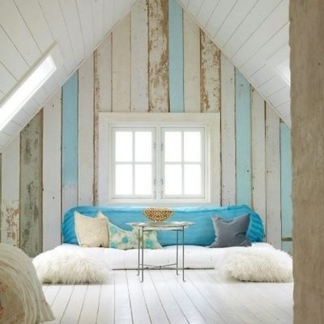 White Washed wood with blue accents. Fun for a little loft for kids above the dock.