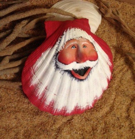 Christmas at the beach sculpted traditional red Santa on scallop sea shell