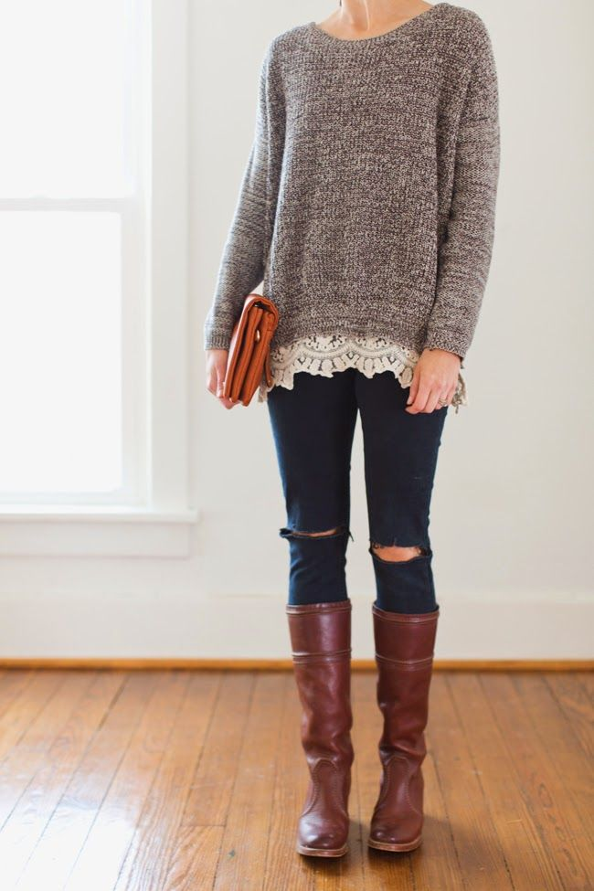 rider boots with ripped jeans gives it edge | Destroyed denim, lace trimmed sweater and cognac boots