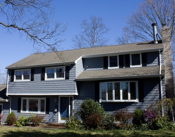 Exterior home makeover by RJW Contracting LLC, Lake Hopatcong, NJ featuring Cedar Impressions polymer siding in Pacific Blue.