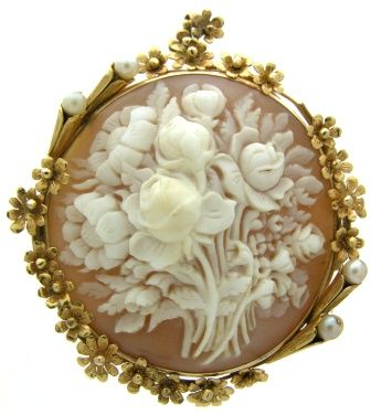 Victorian, circa 1880, 14k gold and shell brooch cameo depicting a bouquet of flowers.                                                                                                                                                     More