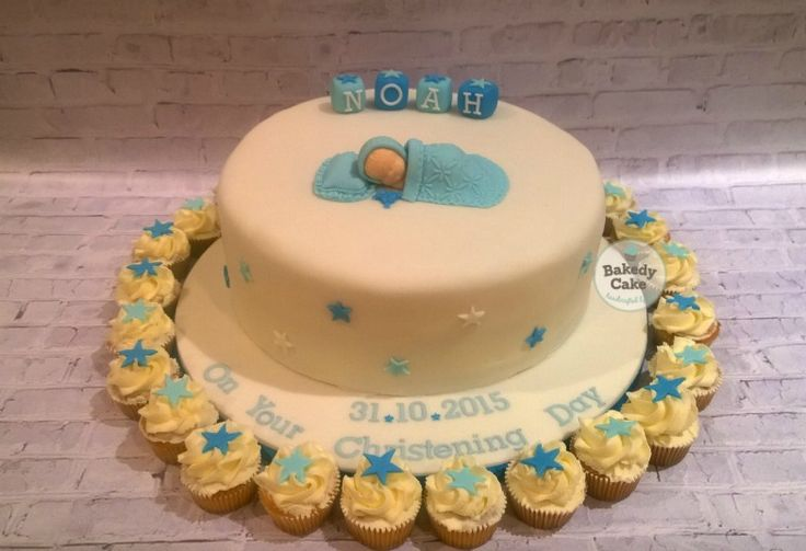 Sleeping Baby Boy Christening cake with matching mini cupcakes by Bakedy Cake