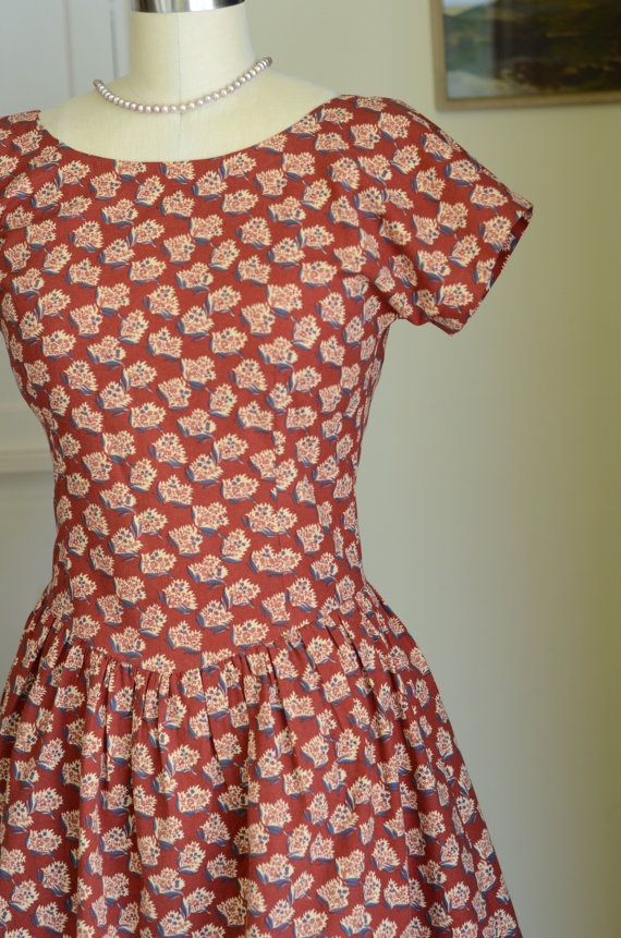 I just added this to my etsy shop. I made this from a vintage 50's pattern. It came out really pretty!