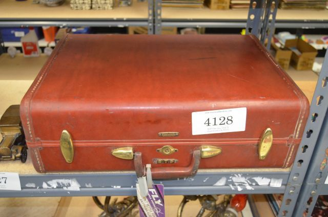 Vintage Samsonite suitcase cherry brown in color