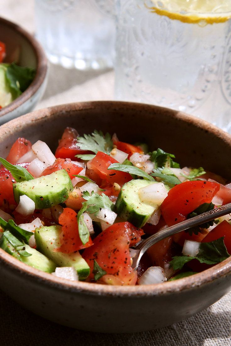 Tomatoes, Persian cucumbers, onion and fresh herbs make up this incredibly refreshing salad. (Jim Wilson/NYT)