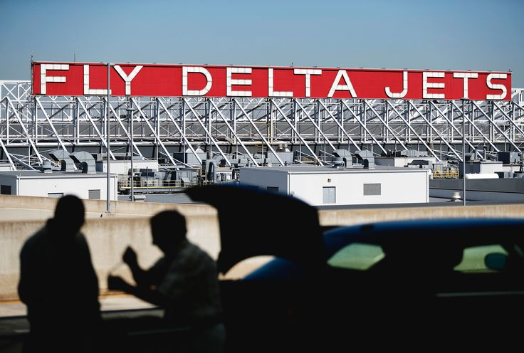 "In this Thursday, Oct. 13, 2016, file photo, a Delta Air Lines sign overlooks the unloading area at Hartsfield-Jackson Atlanta International Airport, (Photo: David Goldman, AP)    Hartsfield-Jackson Atlanta International Airport is forecast to take the 2016 title as the ""World's Busiest... http://usa.swengen.com/worlds-busiest-airport-in-2016-its-atlanta-again/"