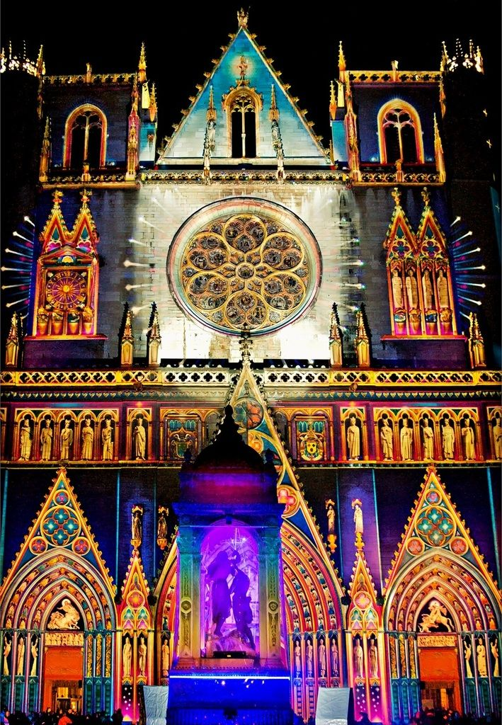 Festival of Lights, Lyon cathedral, France. Bright colourful lights are positioned around the traditional features of the cathedral.