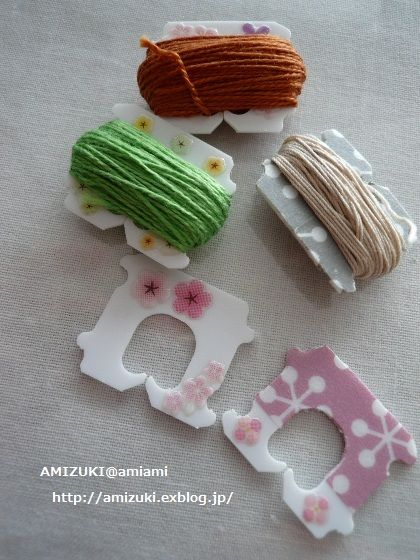 These plastic closures have been decorated with stickers, washi tape, and / or small patterned paper. Then the leftover pieces of floss from a project are wound on and kept for a future use.
