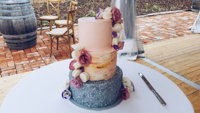 Blush wedding cake by Harans Patisserie. Silver pebble sequin bottom with blush & gold wash middle tier. Add some cascading macarons & blooms