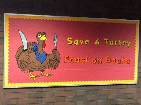 THANKS GIVING LIBRARY BULLETON BOARDS | Turkey holding a fork and knife with the caption: Save a Turkey, Feast ...