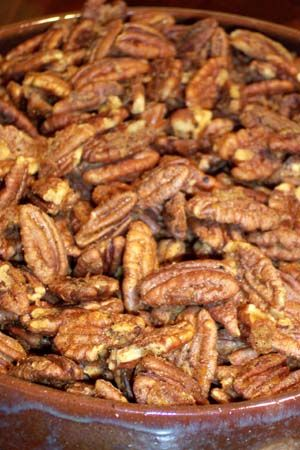 Spiced Pecans - 1egg white, lightly beaten - 2 tds butter, melted - 2 tbs sugar - 3/4 tsp cayenne pepper - 1/2tsp salt - 1/4 tsp freshly ground pepper - 3cupspecan halves. Mix together all ingredients and put on a lined baking sheet. Spread evenly and bake at 300 for about 20 minutes, stirring once to flip the nuts over after ten minutes, and monitoring closely to prevent over baking.