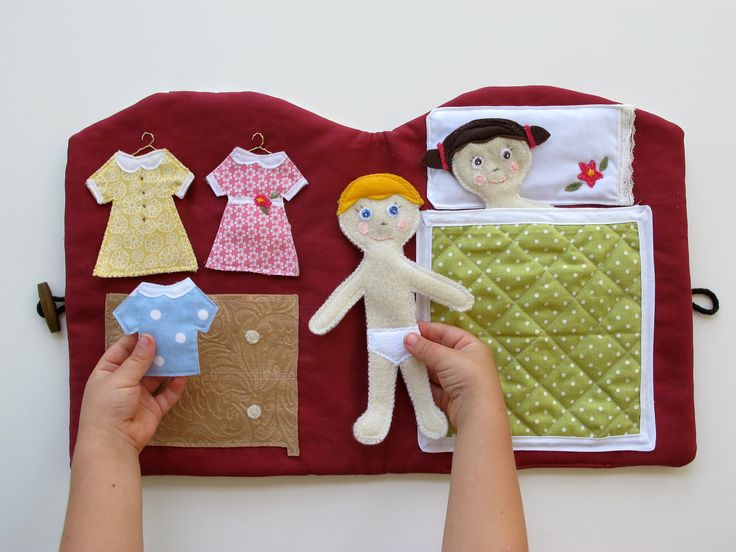 Felt Quiet Book, Handmade Doll House Book, Travel and Church Quiet Book.  Great idea.  You can buy it here or figure out how to make your own.